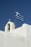 The Greek National Flag Atop a Ai Yiannis Detis Monastery Photographic Print by Sergio Pitamitz