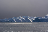 Icebergs and Melting Pack Ice in Ilulissat Icefjord, an UNESCO World Heritage Site Photographic Print by Sergio Pitamitz