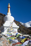 Prayer Flags Adorning a Stupa Flutter in the Wind in the Langtang Valley, Nepal Photographic Print by Alex Treadway
