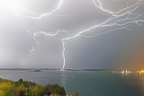 Lightning Surges Through the Sky During a Storm over Casco Bay Photographic Print by Robbie George