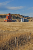 A Grain Elevator and Silos Stand Amid Fallow Wheat Fields in the Gallatin Valley, North of Bozeman Photographic Print by Gordon Wiltsie