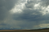 Rain Squalls Hover over Lonely Prairies, Ranchlands and Mountains North of Three Forks, Montana Photographic Print by Gordon Wiltsie