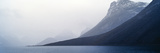 Mist Clings to the Slopes of a Mountain in an Arctic Fjord Photographic Print by Jason Edwards