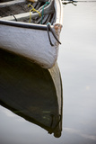 The Bow of a Dinghy Reflected on Water Photographic Print by Robbie George