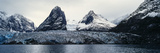 The Sheer Fracture Zone of a Glacier Sandwiched Between Alpine Peaks in a Fjord Photographic Print by Jason Edwards
