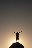 A Hiker Raises His Arms to Celebrate His Success Photographic Print by Macduff Everton