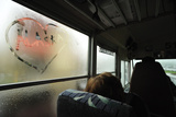 A Heart with the Word Alaska Written in It, on a Steamy Bus Window Photographic Print by Jonathan Kingston