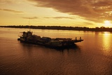 A Barge on Amazon River at Iquitos at Sunrise Photographic Print by Macduff Everton