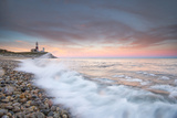 Waves Wash over Cobbles in Front of Montauk Point Lighthouse Photographic Print by Robbie George