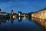 Canals, Bridges and Cafes Along the Bank of Petite France in the Evening Photographic Print by Macduff Everton