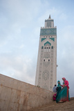 Women in Colorful Djelabas and Head Scarves Walk Down Stairs in Front of Hassan Ii Mosque, Morocco Photographic Print by Erika Skogg