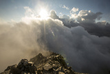 Sunlight Streams Through Clouds onto the Peak of Cima D'Asta Photographic Print by Ulla Lohmann