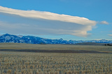 Lenticular Clouds Hover over the Bridger Mountains and Harvested Wheat Fields, Montana Photographic Print by Gordon Wiltsie