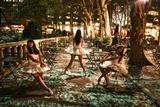 Three Ballerinas in White Tutus Dancing in Bryant Park at Night Photographic Print by Kike Calvo