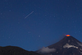 A Small Eruption of the Villarrica Volcano with a Shooting Star Passing Overhead Photographic Print by Mike Theiss