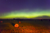 The Aurora Borealis or Northern Lights over Agricultural Land Photographic Print by Mike Theiss