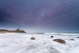 Water Floods the Rocky Shore in Front of Montauk Point Lighthouse Photographic Print by Robbie George
