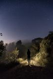 A Hiker Walks Down a Trail under the Stars Reproduction photographique par Ben Horton