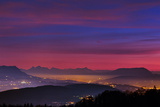 Alps at Dusk with Light of Towns Near the Border of Switzerland and France Photographic Print by Babak Tafreshi