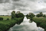 A Canal Cuts Through a Landscape Near the Rhine River Photographic Print by Macduff Everton