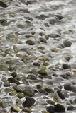 Surf Runs Through Stones on a Beach Photographic Print by Paul Colangelo