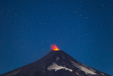 A Small Eruption of the Villarrica Volcano under a Night Sky Full of Stars Photographic Print by Mike Theiss