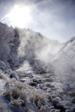 Steam Rising over the Snowy Banks of a Hot Spring Photographic Print by Robbie George