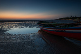 A Lone Fishing Boat at Dusk on Jericoacoara Beach Photographic Print by Alex Saberi