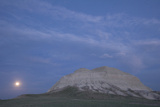 A Butte and the Full Moon in the Oglala National Grassland Photographic Print by Phil Schermeister
