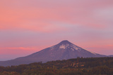 A Red and Pink Sky at Sunset Casting a Reddish Glow on Villarrica Volcano Photographic Print by Mike Theiss