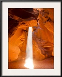 Sunlight Streams Through Cracks in a Slot Canyon Framed Photographic Print by Mike Theiss