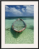 A Boat Submerged in Crystal Clear Water Framed Photographic Print by Bill Curtsinger