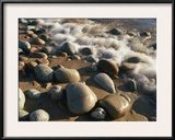 Water Washes up on Smooth Stones Lining a Beach Framed Photographic Print by Michael S. Lewis
