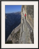 A climber walks a 40-foot-long sliver of granite on Half Dome, named the Thank God Ledge. Framed Photographic Print by Jimmy Chin
