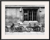 A Row of Bikes Leaning Against an Old School Building in Oxford, England Framed Photographic Print by Keith Barraclough