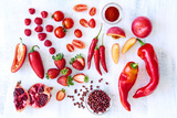 Collection of Fresh Red Toned Vegetables and Fruits Raw Produce on White Rustic Background, Peppers Photographic Print by  warrengoldswain