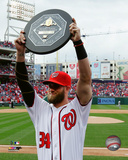 Bryce Harper holds up the 2015 MVP trophy Photo