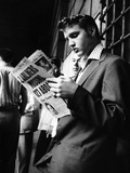 Elvis Presley Reading the Paper in London, 1958 Stretched Canvas Print