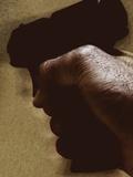 Hand Holding Gun Photographic Print by Torsten Richter