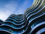 Modern Building with Aeroplane Above Fotografisk tryk af Craig Roberts