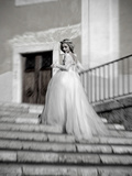 Young Adult Female in Long Wedding Dress Standing on Steps Photographic Print by Steven Boone