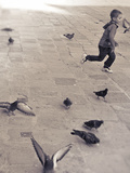 Child Running across Stones, Venice, Italy Photographic Print by Steven Boone