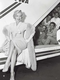 Marilyn Monroe in Airport Posters by Sam Schulman