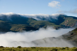 View of valley shrouded in fog at dawn, Mountain Zebra , Eastern Cape, South Africa Photographic Print by Chris & Tilde Stuart