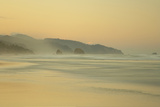 View of beach and distant sea stacks at dusk, Cannon Beach, Oregon, USA Photographic Print by Bill Coster