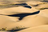 View of sand dunes in desert habitat, Khongoryn Els Sand Dunes, Southern Gobi Desert, Mongolia Photographic Print by David Tipling