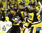 The Pittsburgh Penguins celebrate winning in overtime during the 2016 NHL Stanley Cup Playoffs Photo