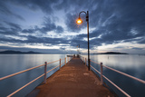 Pier of Lake Trasimeno at Dusk, Perugia, Umbria, Italy. Photographic Print by  ClickAlps