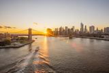 Usa, New York, Lower Manhattan Skyline and Brooklyn Bridge over East River at Sunset Photographic Print by Alan Copson