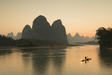Cormorant Fisherman on Li River at Dusk, Xingping, Yangshuo, Guangxi, China Photographic Print by Ian Trower
